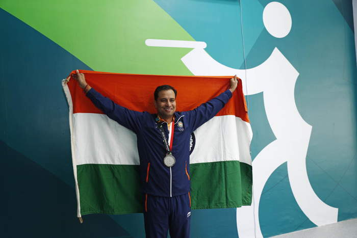 Silver medallist Sanjeev Rajput of India holds up the national flag after winning the Asian Games Men's 50m Rifle 3 Positions Final, at the JSC Shooting Range in Palembang, Indonesia, Reuters/UNI