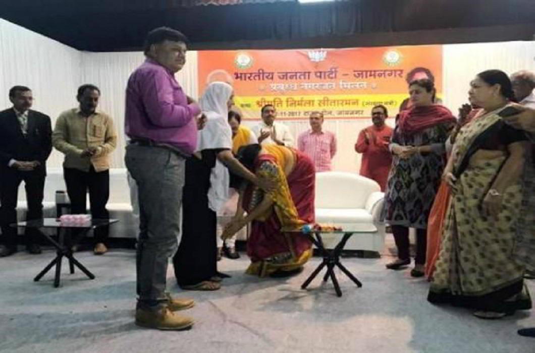 Defence Minister Nirmala Sitharaman touches feet of Martyr's mother