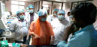 Uttar Pradesh Chief Minister Yogi Aditiyanath visits the children ward at BRD Medical College hospital in Gorakhpur while on inspection on August 9, UNI