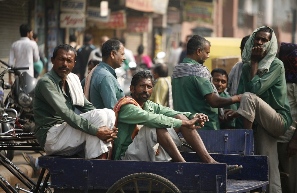 Porters without work in Chandni Chowk, Delhi. Photo: Anil Shakya