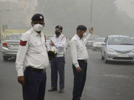 Traffic police wearing pollution mask