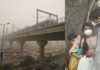 (L-R) A metro train zooms past smog in New Delhi; A couple wearing mask to avoid dangers of smog. Photo: Anil Shakya-1