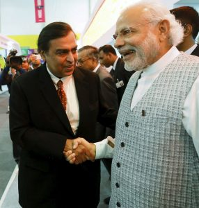 Chairman and MD of RIL, Mukesh Ambani with Prime Minister Narendra Modi. RIL has seized the chance to launch Jio payments, in a joint venture with SBI