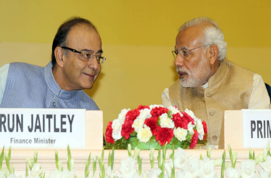 A file picture of Prime Minister Narendra Modi in conversation with Union Finance Minister Arun Jaitley (Left) during the Delhi Economics Conclave 2015, in New Delhi. Photo: UNI