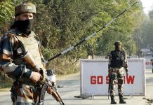 Army jawans keeping strict vigil at the main gate of the Army Camp of 46-RR, at Janbazpora in Baramulla district, Jammu and Kashmir