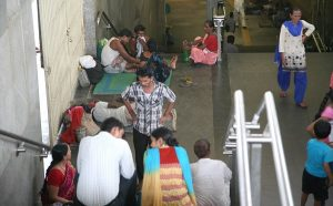 Unattended patients of AIIMS taking shelter at AIIMS metro station. Patients like these fall prey to touts more often. Photo: Anil Shakya