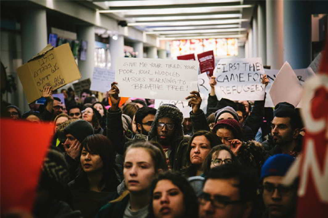 Protesters against President Donald Trump's immigration order gather at O'Hare International Airport in Chicago, Illinois, on Jan. 28, 2017. (Dakota Sillyman/NurPhoto/Sipa USA via AP Photo)