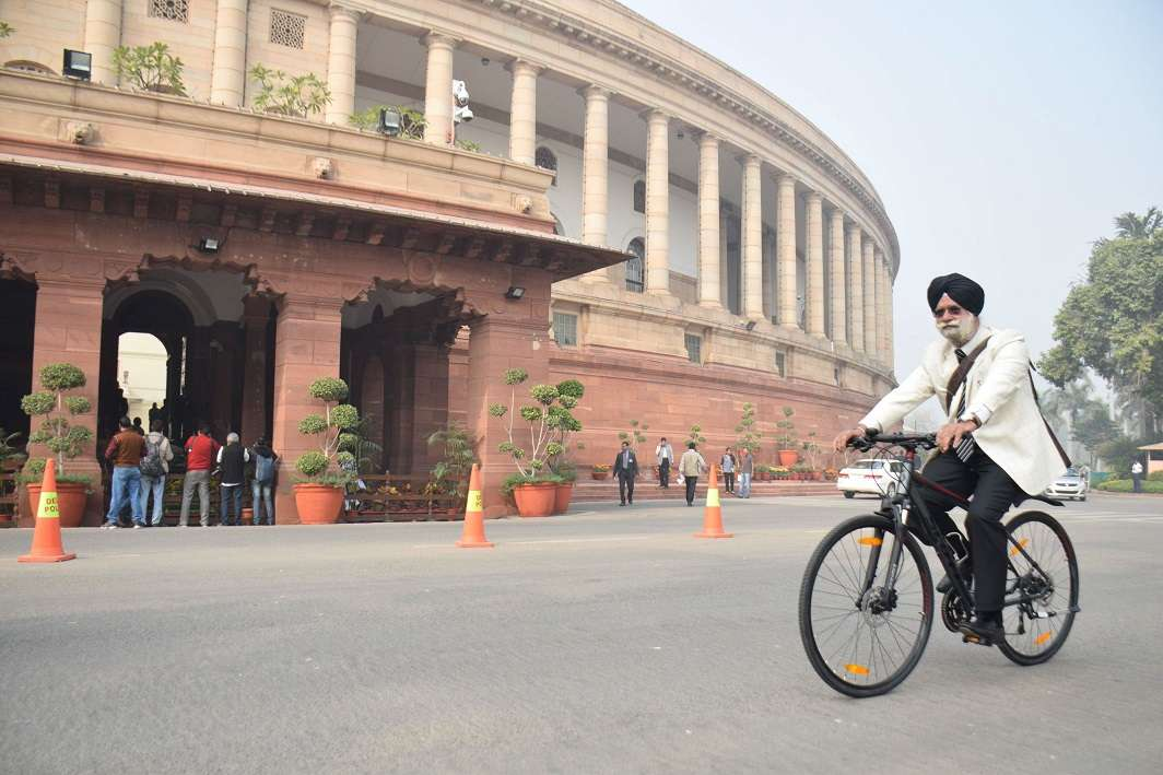 Rajya Sabha member KTS Tulsi arriving at Parliament House on his bicycle. Photo: UNI
