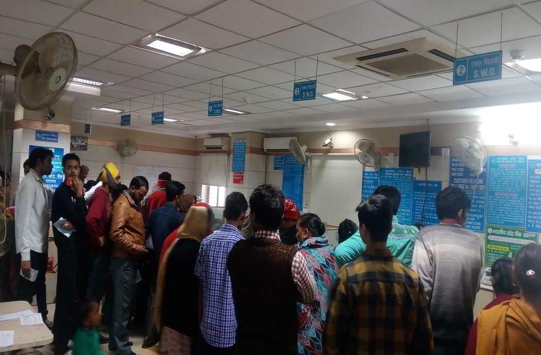 People queuing up in the Raghubir Nagar branch of SBI