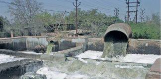 Poorly treated waste water being released into the river. Photo: Rakesh Jaiswal