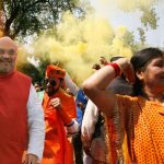 (L-R) BJP president Amit Shah; party workers soaking in the emphatic victory in UP at BJP headquarters