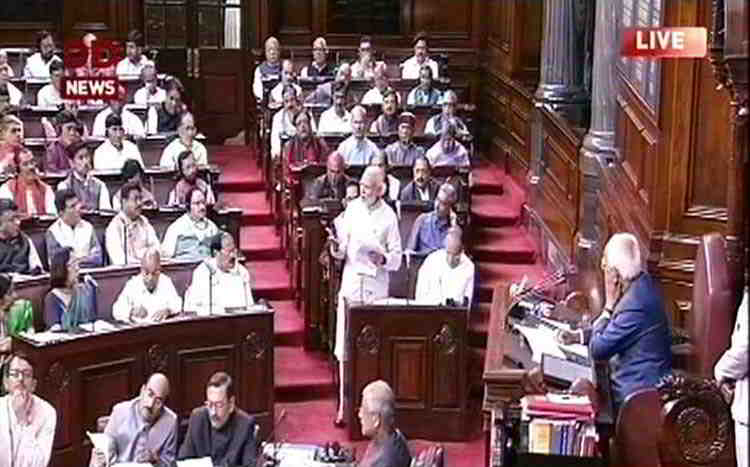Prime Minister Narendra Modi addressing the Rajya Sabha. The government wants to bypass the Upper House by clearing the Aadhaar Act as a Money Bill. Photo: UNI