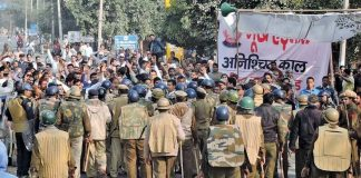 Jat protestors block a road in Jind, Haryana, to demand reservation in government jobs. Photo: UNI