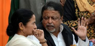 West Bengal CM Mamata Banerjee and TMC leader Mukul Roy. Photo: UNI