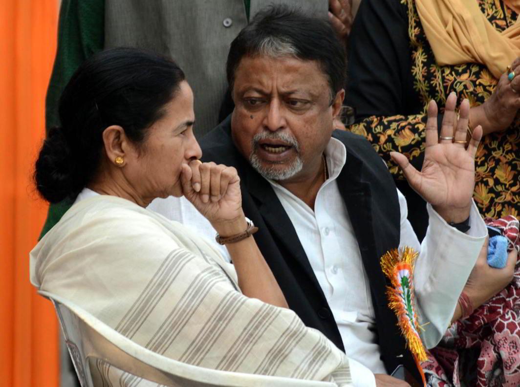 West Bengal CM Mamata Banerjee and TMC leader Mukul Roy. Photo: UNI