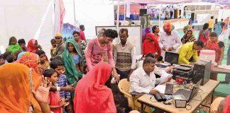 People queue up for an Aadhaar card. Photo: UNI
