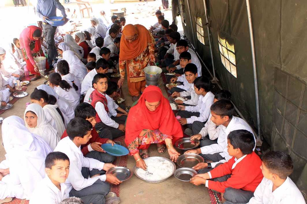 Mid Day meal being served to school children in Doda, Jammu and Kashmir. Photo: UNI