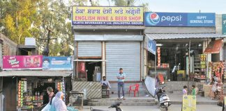 Closed liquor shops along a highway in Punjab