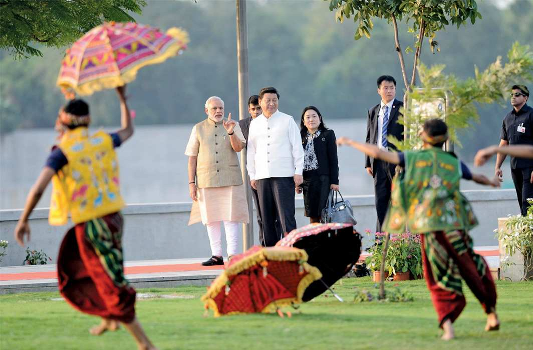 Chinese President Xi Jinping with Narendra Modi on the banks of Sabarmati river during his India visit in 2014,photo: UNI