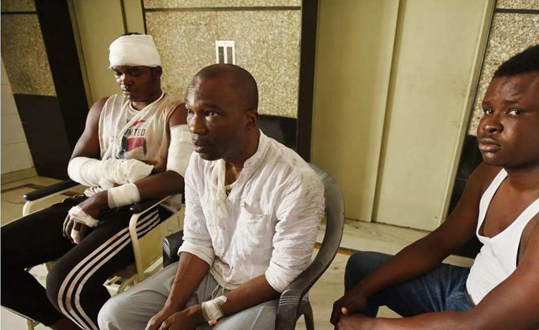 A video grab of African students recuperating in a hospital after they were beaten up