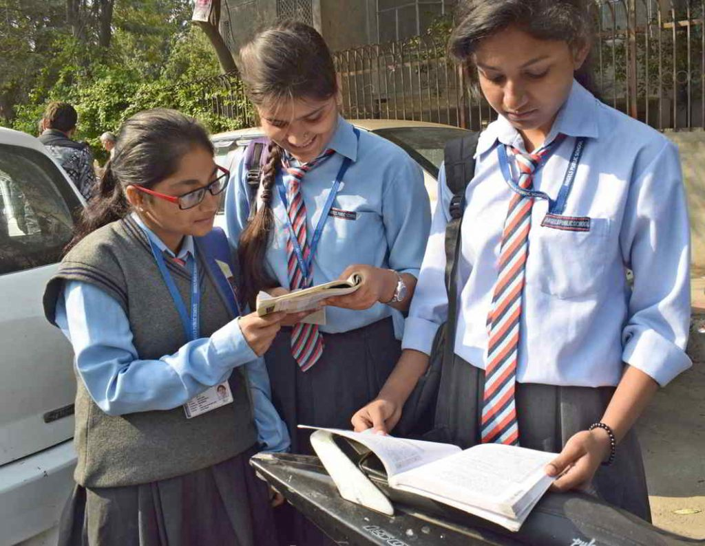 Students appearing for CBSE class 12th Board examination revising the subject just before the Examination begins at a centre, in New Delhi. Photo: UNI
