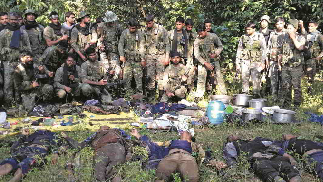 CRPF personnel with the bodies of CPI (Maoists) members after a gunbattle at Chipadohar Forest in Jharkhand. Photo: UNI