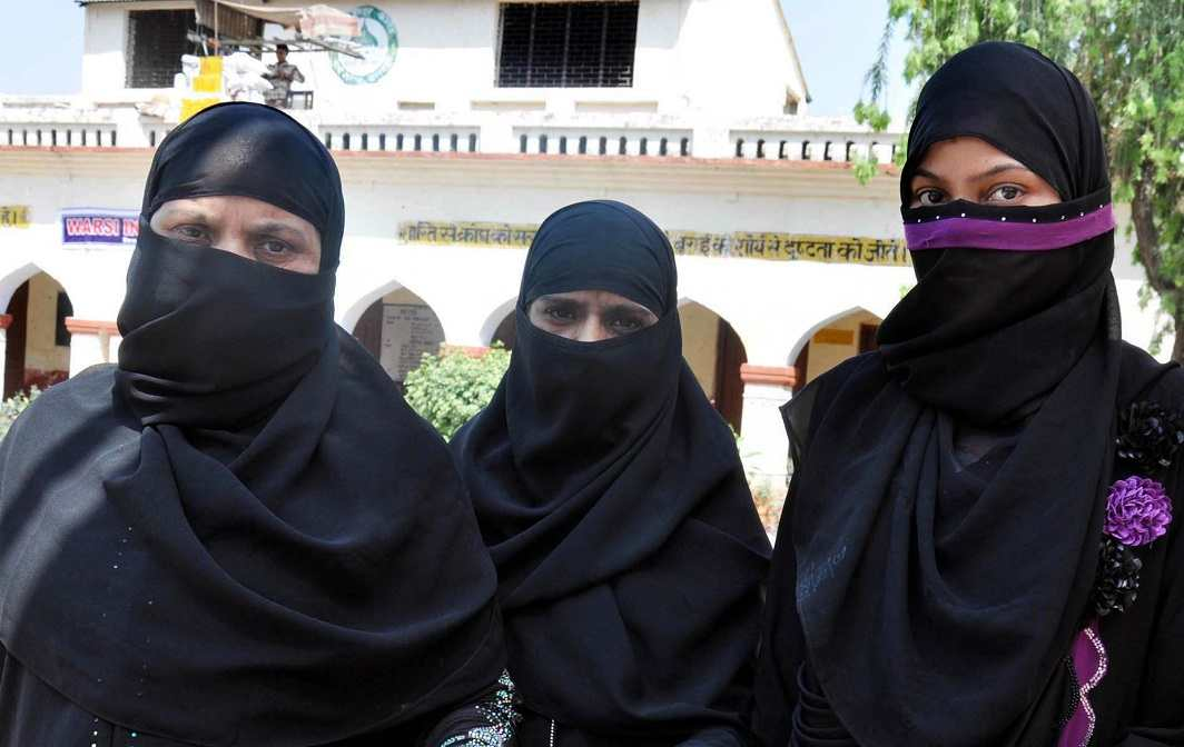 Muslim voters showing inked fingers after casting their vote. Photo: UNI