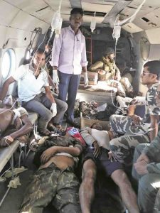 CRPF personnel injured in a Naxalite attack at Sukma being taken for treatment by a helicopter to Jagdalpur. Photo: UNI