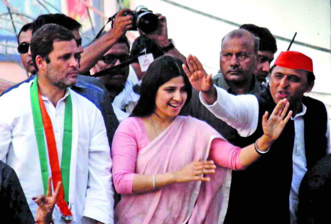 Former UP chief minister and SP president Akhilesh Yadav (far right) with wife Dimple and Congress vice-president Rahul Gandhi during a road show in Varanasi