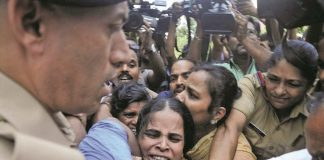 Police forcibly removing Prannoy's mother, demanding a fair probe, in Thiruvananthapuram. Photo: UNI