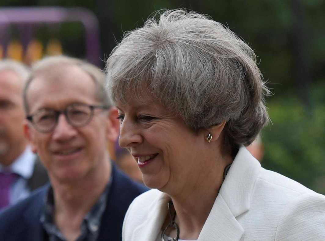 Britain's Primer Minister Theresa May and her husband Philip leave a polling station in Britain