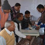 Polling officers with EVMs at a training camp ahead of the 2017 Uttar Pradesh assembly polls. Photo: UNI