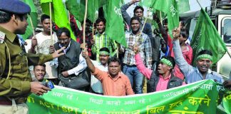 Activists of Adivasi Jan Parishad agitate on the land acquisition issue in Ranchi. Mining projects are often at variance with their livelihood. Photo: UNI