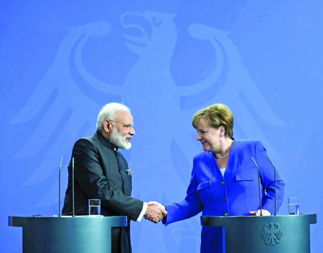 Prime Minister Modi with German Chancellor Angela Merkel in Berlin. Photo: UNI