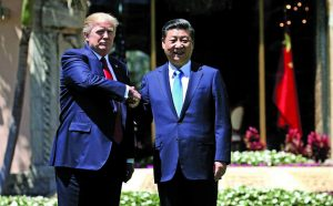 US President Donald Trump (L), who has pulled out of the Paris pact, shakes hands with China's President Xi Jinping in Florida. Photo: UNI