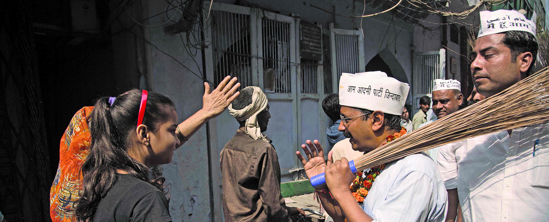 Delhi Chief Minister Arvind Kejriwal wields a broom. Photo: Anil Shakya