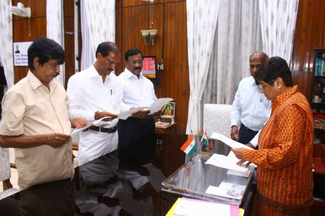 Kiran Bedi administering the oath to three MLAs nominated by the BJP