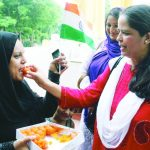 Muslim women offering sweets to each other in Lucknow following the Supreme Court order on triple talaq. Photo: UNI