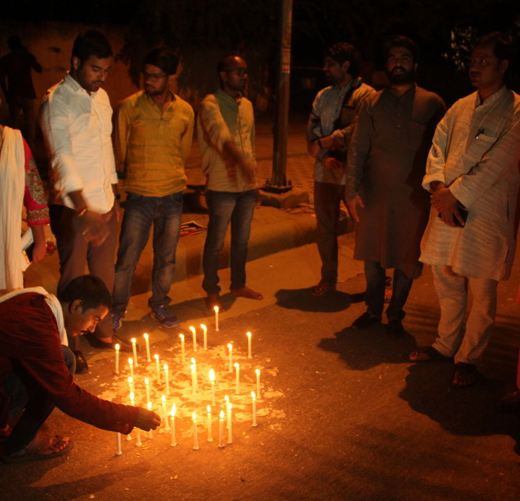 Students of BHU lighting candles to mark their protest against the lathi-charge incident. Photo: Bhavana Gaur