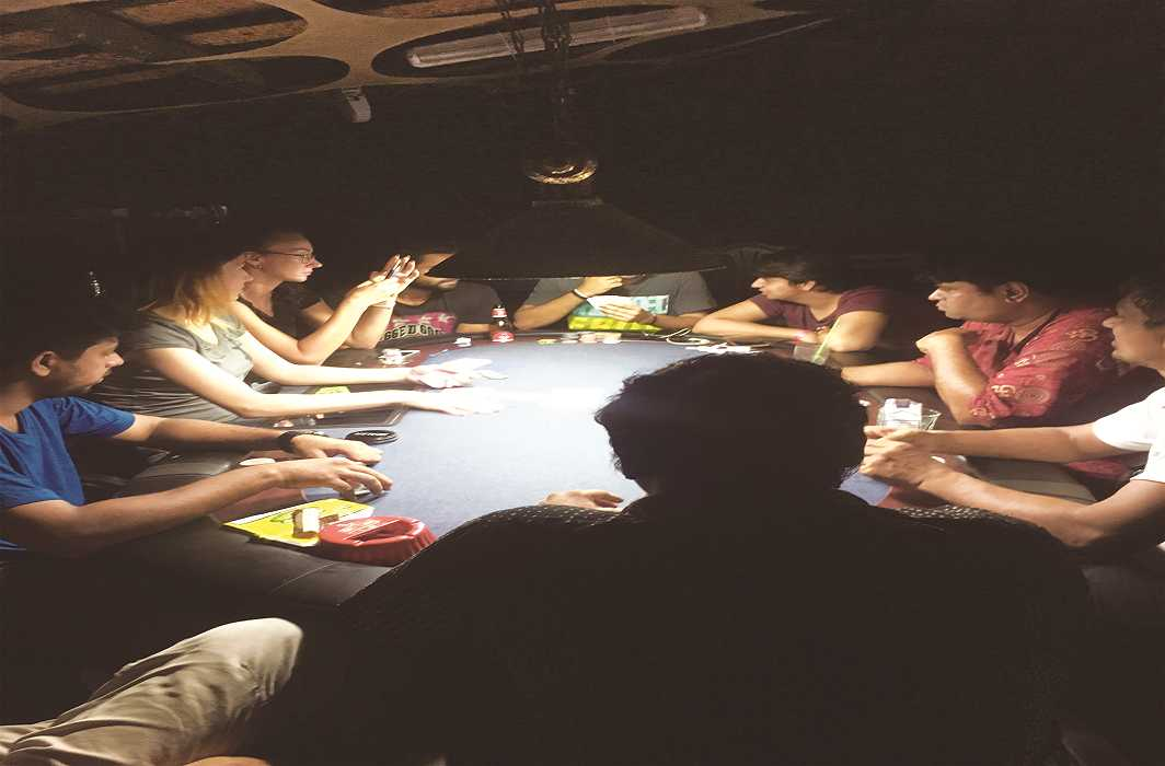 People playing cards at a get-together. Photo: Bhavana Gaur