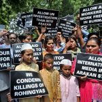 Rohingya Muslim refugees along with Indian supporters hold placards against human rights violations in Myanmar during a protest in New Delhi (file picture).