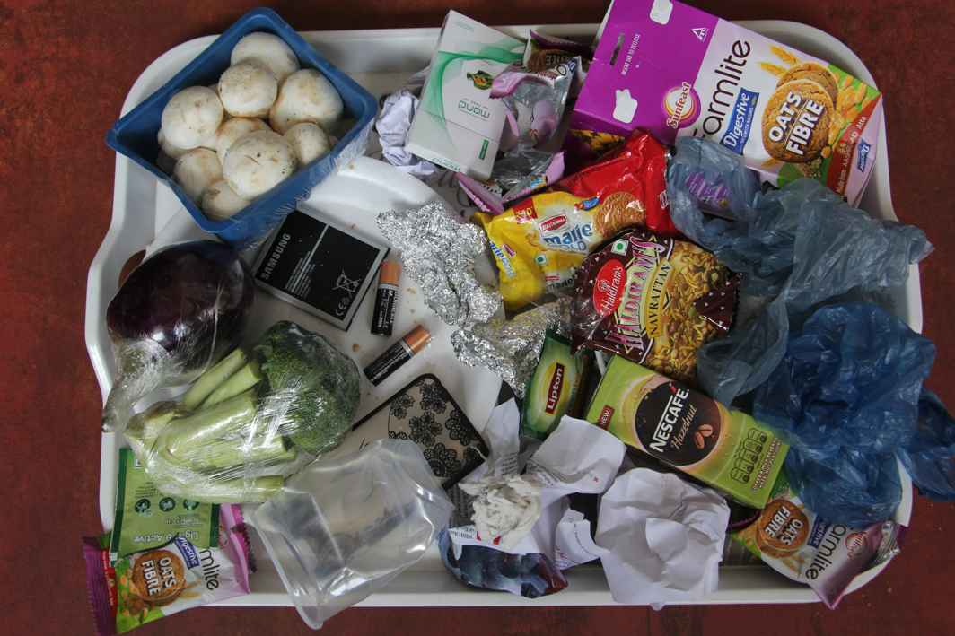 Food leftovers, plastic wrappers, tetra packs, batteries and so on that make up daily waste. Photo: UNI