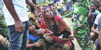 A Rohingya woman waits to receive aid in Cox's Bazar, Bangladesh. Photo: UNI
