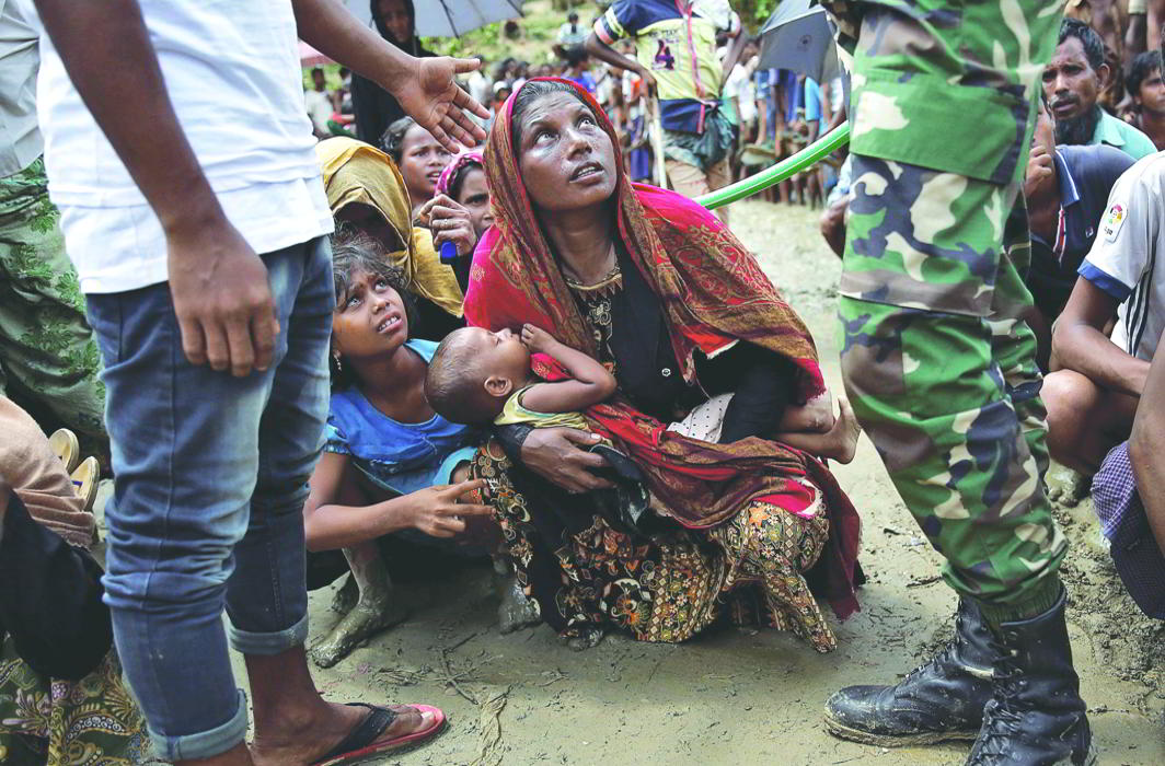 A Rohingya woman waits to receive aid in Cox's Bazar, Bangladesh. Photo: UNI
