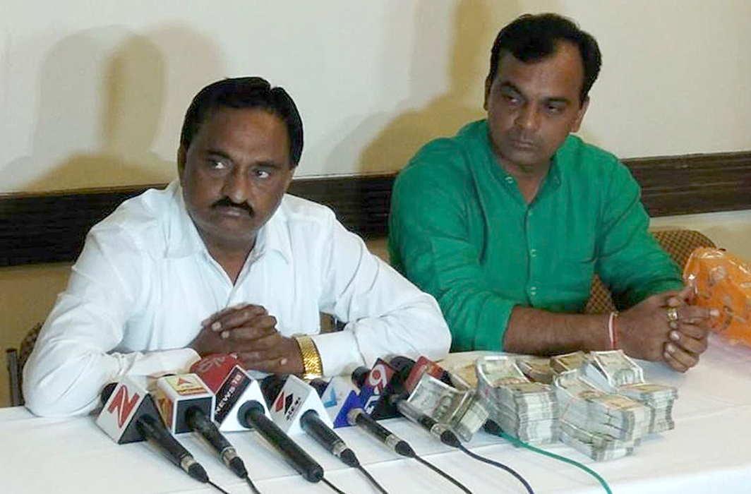 Narendra Patel (in white shirt)