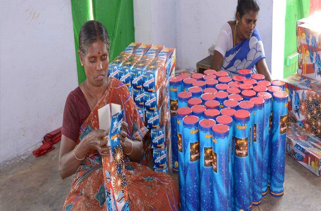 Women laborers working in a firecracker unit