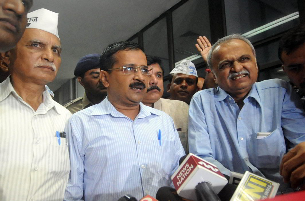 Delhi Chief Minister Arvind Kejriwal (centre) arrives at Ahmedabad Airport during his three day visit in Gujarat (file picture). Photo: UNI