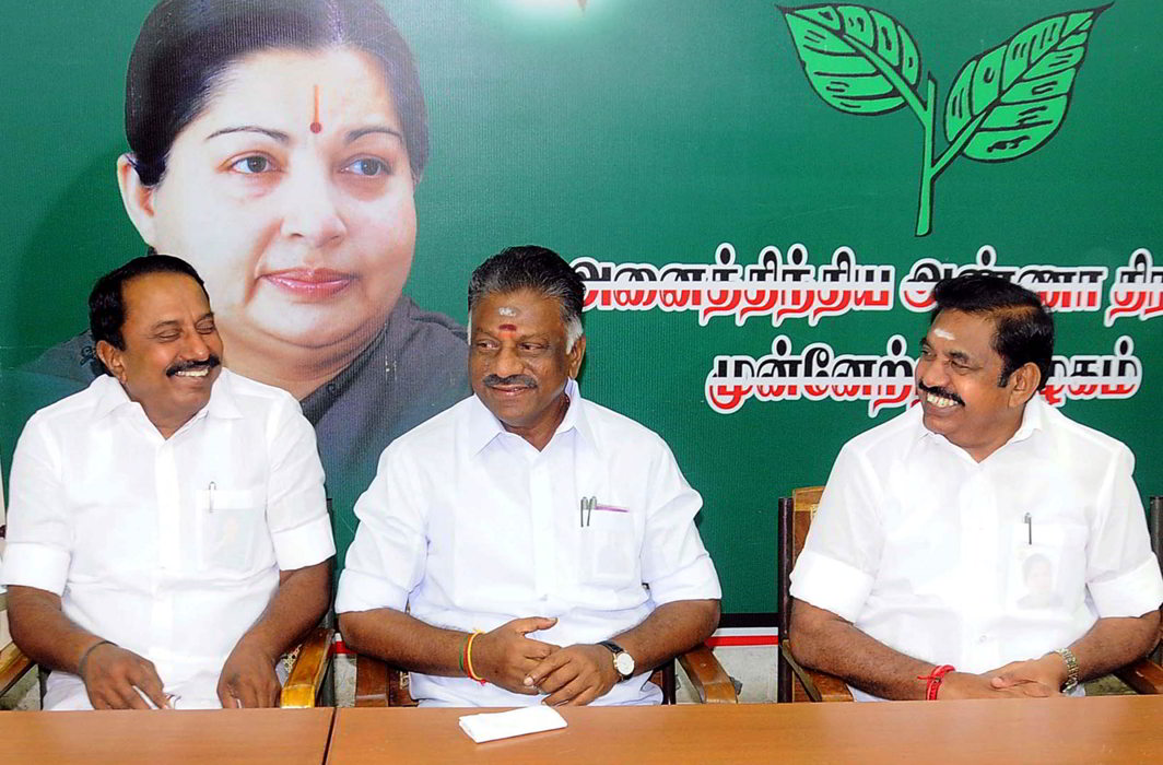 Tamil Nadu Chief Minister K Palaniswami and Deputy Chief Minister O Panneerselvam, along with senior AIADMK leaders at a party meeting. The EC has ruled in the favour of the OPS-EPS faction. Photo: UNI