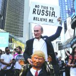 Protestors dressed as Russia's President Vladimir Putin and US President Donald Trump, in New York. Photo: UNI