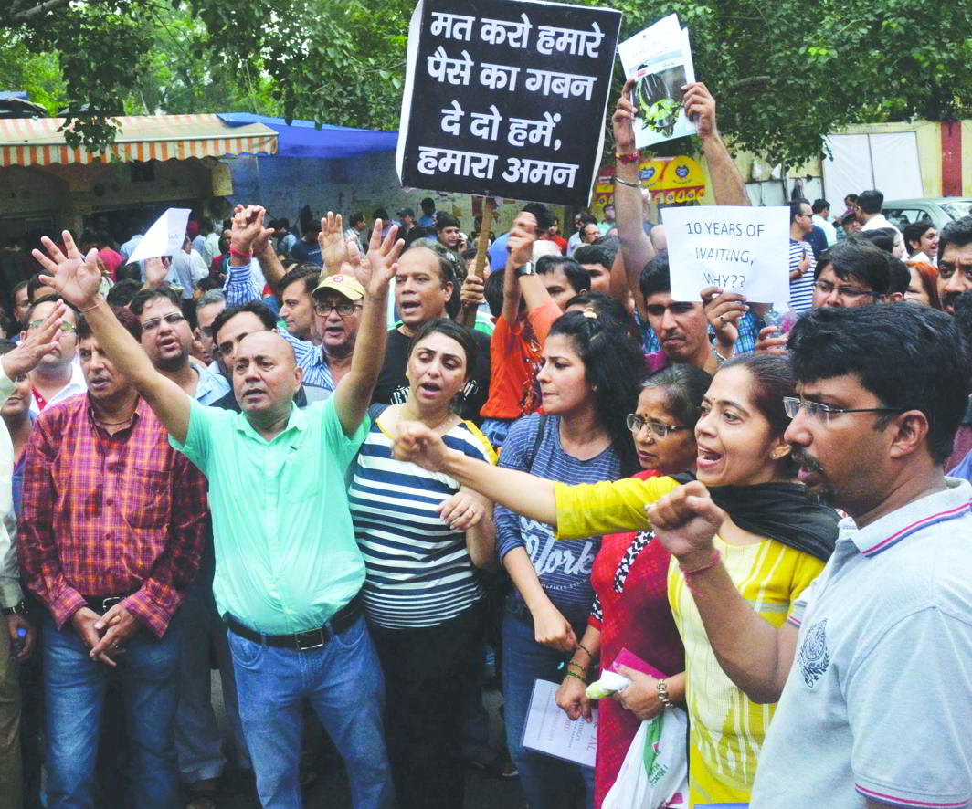 Jaypee flat buyers protesting against the delay in allotment of their flats, in New Delhi. Photo: UNI